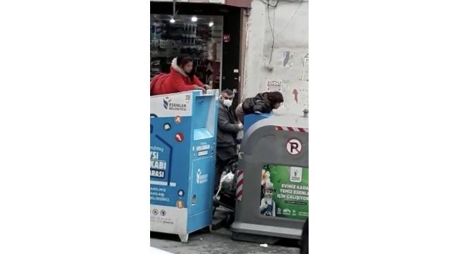 Yasağa uymayan çocuklar, çöp konteynerine girerek giysi topladı